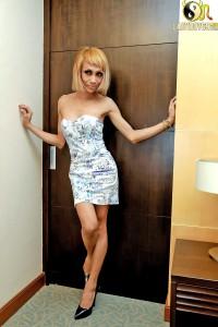 slender blonde shemale girl posing